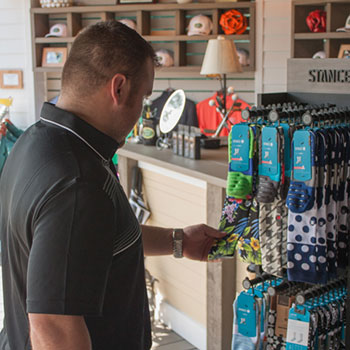 A guest looks at Stance Socks at the Pro Shop