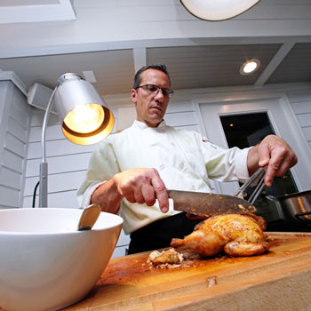 Chef slices a Cornish Game Hen on the Fairway Buffet