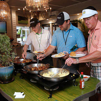 Guests line up for breakfast served at the Fairway Buffet